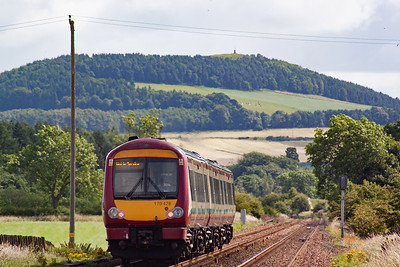 Tarvit Hill rises in the background as 170478 speeds on. The set will run empty to Dundee to reverse once the passengers have disembarked.