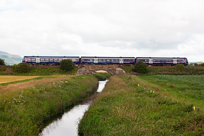 This working is a normally timetabled one, 2G16 0828 Dundee to Edinburgh. The unknown set is crossing the River Eden.