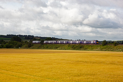A pair of class 170 turbostars drop down the bank with the 0748 off Edinburgh to Leuchars golf special. Once the passengers get off at Leuchars the sets run on ECS to Dundee.