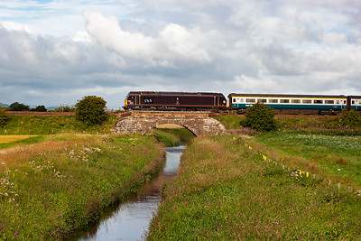 67005 passes over the small bridge carrying the railway over the youthful River Eden.