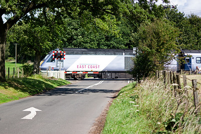 East Coast main line meets Fife back road. 43318 passes over Bow of Fife level crossing bound for London.