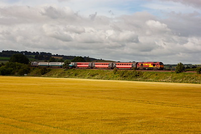 A patch of morning sun catches the trailing loco and the ex Virgin coaches. 67005 and 67011 head for Edinburgh.