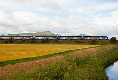 East and West Lomond are visible behind the sets as they speed on to Leuchars. They are not booked to stop at Ladybank.