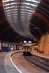 The gentle sweep of the train shed is matched by the gentle sweep of the track and platform below it. 150275 sits in bay platform 8 shut down.