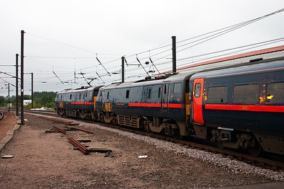 91129 with 91128 DIT gets away from York. With a maximum of 6,300hp available the added weight of a dead class 91 loco, 84 tonnes, will not have any effect on 91129.