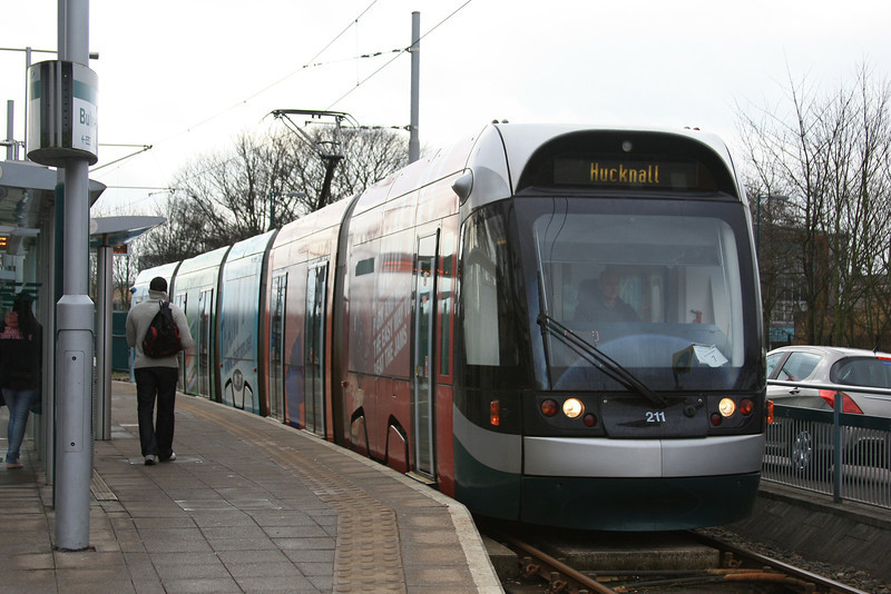 "Nottingham Express Transit tram 211 ""Tram It"" sits on Bulwell station 17.02.12"