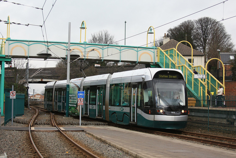 """Nottingham Express Transit tram 202 """"DH Lawrence"""" arrives with a train to Station Street 17.02.12"""