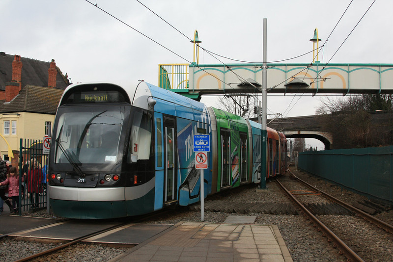 "Nottingham Express Transit tram 211 ""Tram It"" departs with a train to Hucknall 17.02.12"