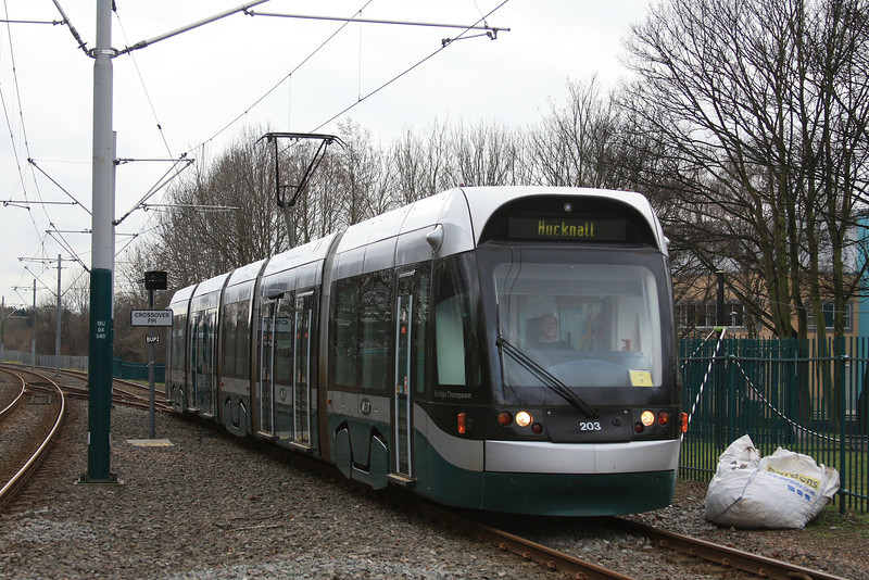 "Nottingham Express Transit tram 203 ""Bendigo Thompsom"" arrives with a train to Hucknall 17.02.12"
