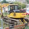 Quattro Plant Komatsu PC128US Crawlerailer No: 515 UIC: 99709 911143-4 stabled in the yard 04.10.15