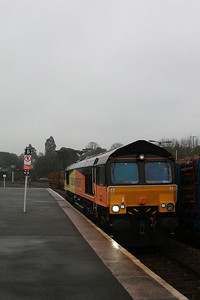 66846 heads up Platform 2 running around it consist of timber wagons 21.03.13