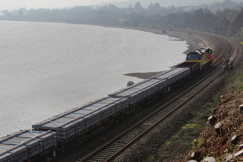 70801 at the front of a few loaded YWAs just outside of Teignmouth 29.03.14
