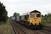 After waiting for 153309 to return back towards Ipswich, 66564 follows working 4E50 Felixstowe North - Leeds 04.09.12