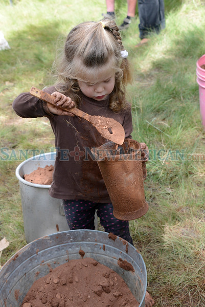A large group of adults and children turned out to celebrate the earth and nature as they played in the mud during the Railyard Park Conservancy's free public Mud Day in the Railyard Saturday July 2, 2016. Clyde Mueller/The New Mexican