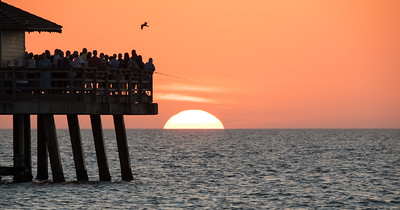 Naples fishing pier at sunset over the Gulf of Mexico