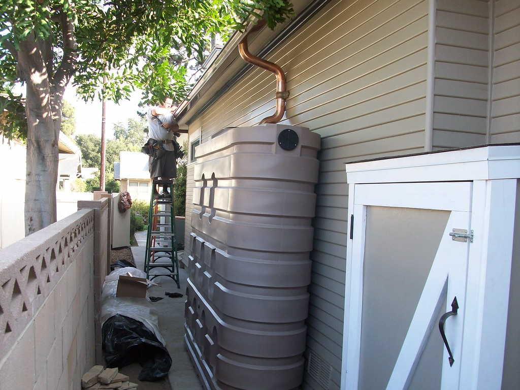 "620 gallon slimline tank with copper gutters in Orange, Ca. <a href=""http://www.rain-watersystems.com/"">http://www.rain-watersystems.com/</a>"