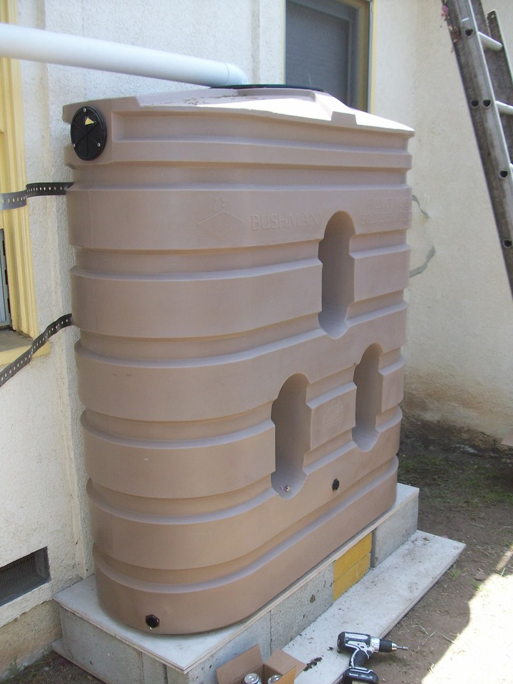 "The overflow can be placed on either side of the tank and this photo shows two of the various hose connection points. <a href=""http://www.rain-watersystems.com/"">http://www.rain-watersystems.com/</a>"