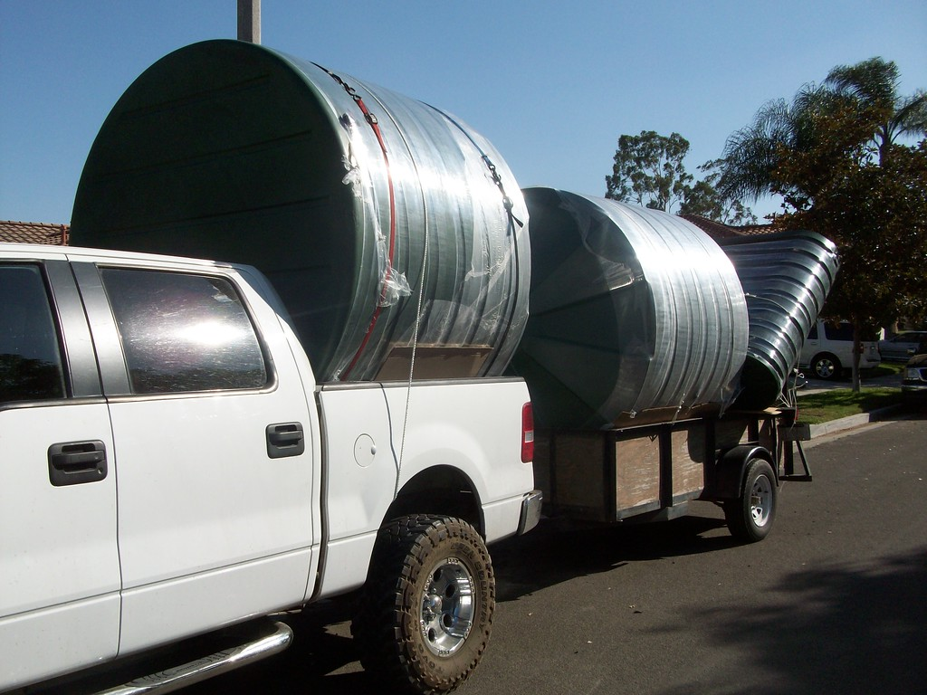 "The large tanks are logistically challenging to transport, but you need to have a large capacity to deal with the large amount of rain water your roof collects, even in a dry area like Southern California.<br /> The cisterns may be considered part of an Earthquake emergency plan or used to fight fires.<br /> 1000 square feet of roof area yield 8700 gallons of water per year in Anaheim. If the water were collected at just The Disney Hotel an estimated average of 320000 gallons per year of water could be saved. <a href=""http://www.rain-watersystems.com/"">http://www.rain-watersystems.com/</a>"