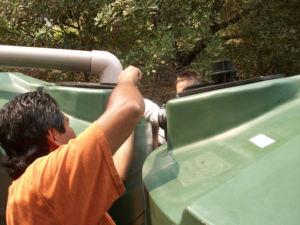 "Installing the over flow connections in a large system.<br /> <br />  <a href=""http://www.rain-watersystems.com/"">http://www.rain-watersystems.com/</a>"