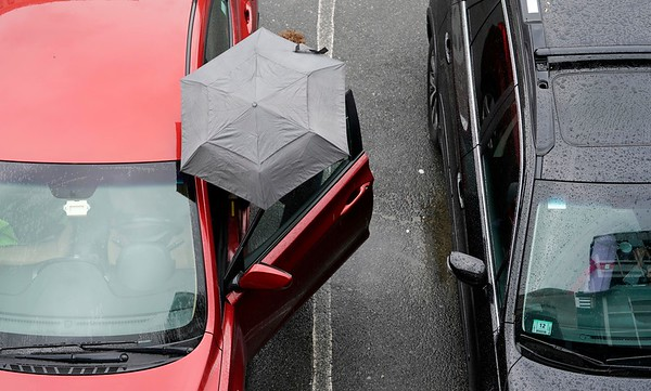 BEN GARVER — THE BERKSHIRE EAGLE<br /> A woman enters her car at the McKay Street lot. With rain forecast for the entire day, there is no escaping the rain in Pittsfield.