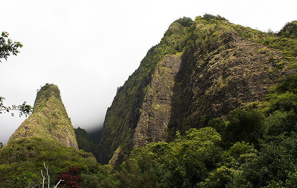 The Needle (left) faces the remnants of the wall rocks of the West Maui Mountains caldera. The Needle is a remnant of the floor of the caldera.