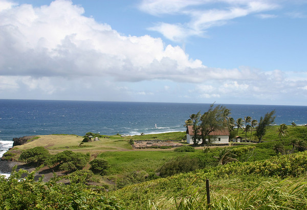 Hui Aloha Church and graveyard, west of Oheo Gulch in east Maui. Note the insanely brave windsurfer just offshore near center of photo. Also note the palm trees bent over by the strong prevailing winds on this isolated point of land.