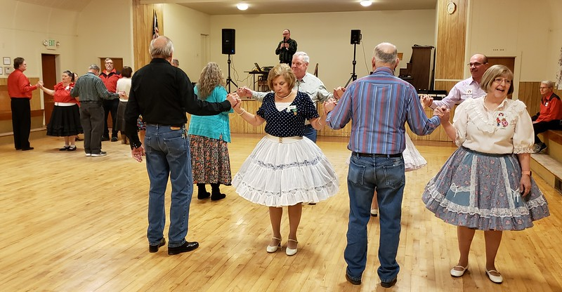 Feb. 22, 2020; square dancers prepared for the next call.