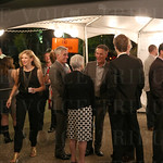 The event was held on a beautiful evening. Guests enjoyed the opportunity to mingle at the registration tent.