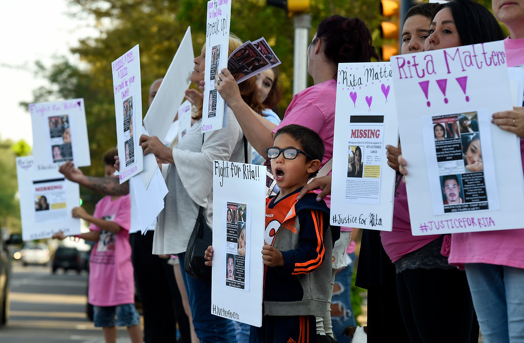 . Isaac Garcia, 5, holds a sign and yells as cars pass by while trying to raise awareness for the disappearance of Rita Gutierrez-Garcia on Friday on Main Street in Longmont. For more photos go to dailycamera.com Jeremy Papasso/ Staff Photographer 08/03/2018