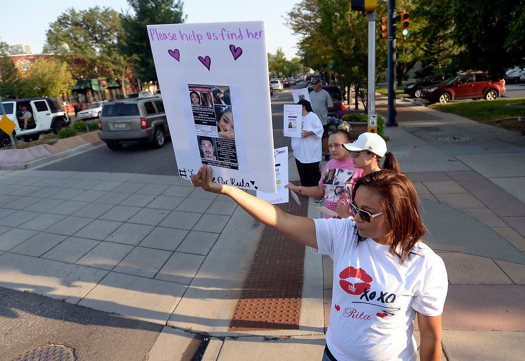 . Family friend Catalina Prospero holds a sign while trying to raise awareness for the disappearance of Rita Gutierrez-Garcia on Friday on Main Street in Longmont. For more photos go to dailycamera.com Jeremy Papasso/ Staff Photographer 08/03/2018