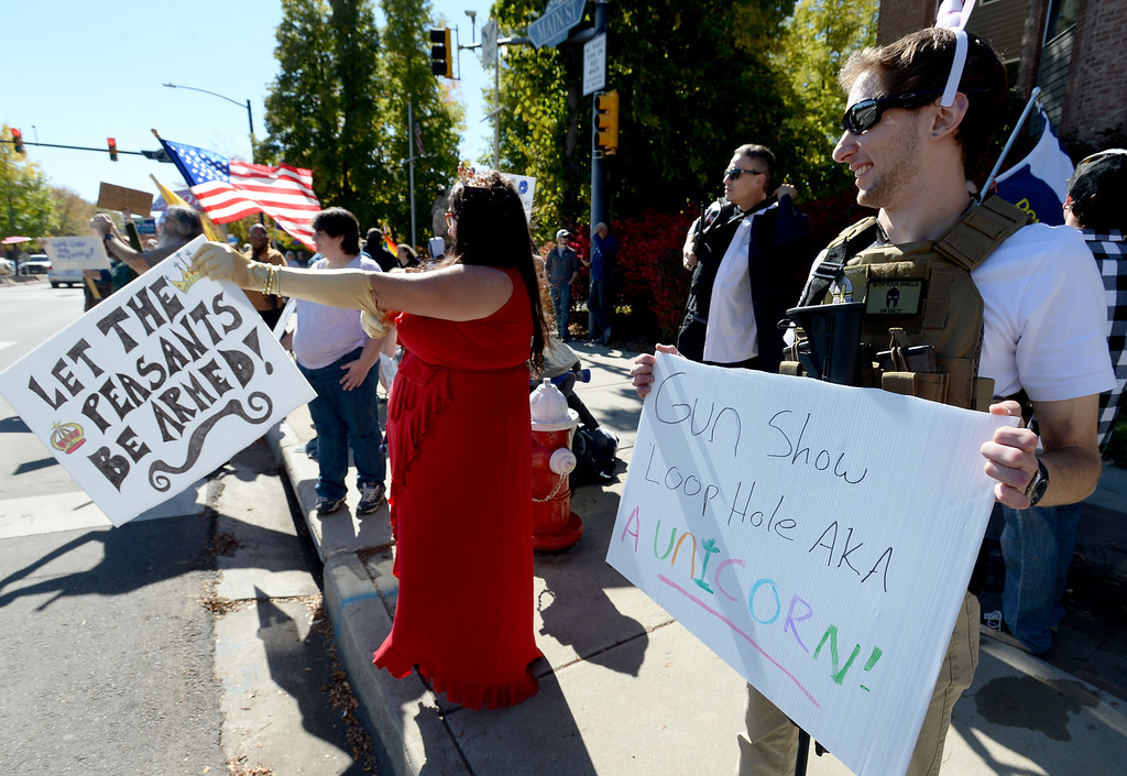 . LONGMONT, CO - October 13, 2018: Lesley Hollywood, left, and Patrick McClintock, were dressed up to support gun rights. The Rally For our Rights for gun supporters was held in Longmont along with the weekly peace rally in the same location on Main Street.  (Photo by Cliff Grassmick/Staff Photographer)