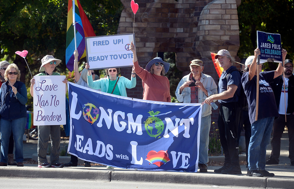 . LONGMONT, CO - October 13, 2018: The usually rally to promote peace and to vote was also held at 6th and Main Street. The Rally For our Rights for gun supporters was held in Longmont at the same location.  (Photo by Cliff Grassmick/Staff Photographer)