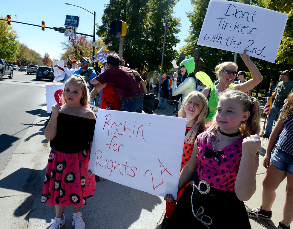 . LONGMONT, CO - October 13, 2018:Tessie Hardin, left, her sister, Taley,  her friend Britney Gasthler, and her mother, Kelley Hardin, rallied for guns rights on Saturday. The Rally For our Rights for gun supporters was held in Longmontalong with the weekly peace rally also in the same location.  (Photo by Cliff Grassmick/Staff Photographer)