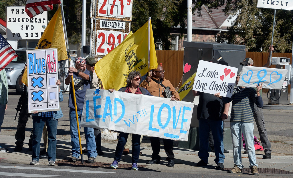 . LONGMONT, CO - October 13, 2018: The Rally For our Rights for gun supporters was held in Longmont along with people promoting peace and to vote out the GOP.  (Photo by Cliff Grassmick/Staff Photographer)