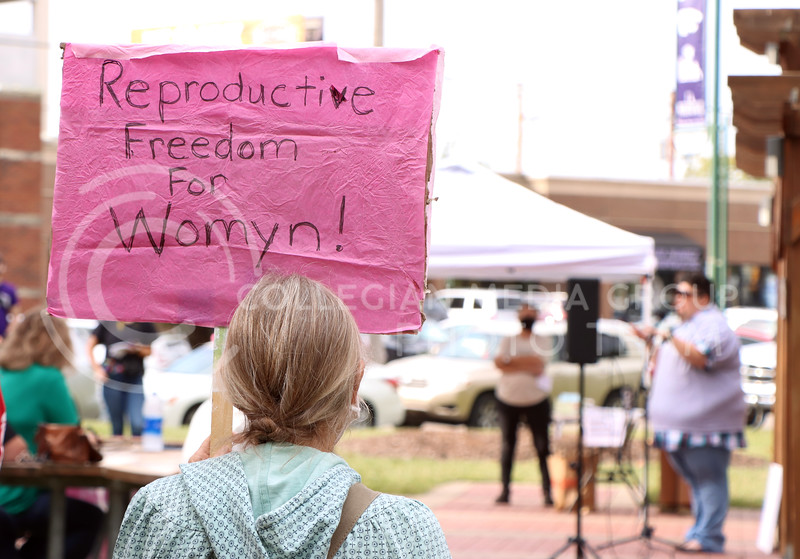 Manhattan community members gather at triangle park to defend reproductive rights on Saturday October 2. (Elizabeth Sandstrom | Collegian Media Group)