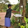Lorraine's beautiful friend Elizabeth tests the wash basin at the far corner of the Masai Lodge restaurant.