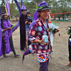 Fun purple outfits with dragon tail at Soysambu Wild Festival supporting wildlife and peace.