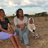 Dear Kitengela neighbors and friends Elizabeth, daughter Sharon and granddaughter Marsha enjoy the open breeze.