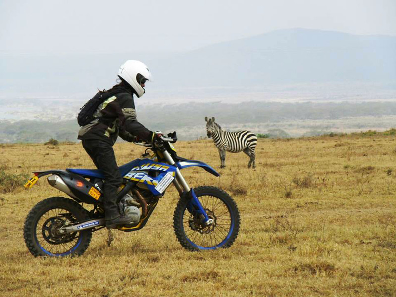 Tiffany rides past the zebra at Soysambu Conservancy, Kenya.