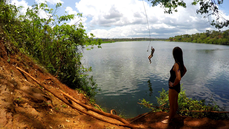 Tiffany watches as I jump into the Nile River for the first time outside of Jinja, Uganda.