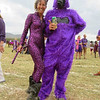 Nicole has fun in her wild cat outfit next to gorilla man at the Soysambu Wild Festival where everyone dressed in wild outfits.