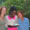 Tiffany and Lorraine snuggle up to birthday girl Lucy at Alastair's beautiful home in Kampala, Uganda.