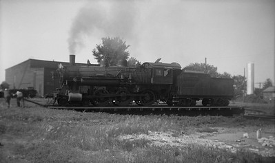 2021.001.NO.03.003--ralph wehlitz 116 neg [photographer unknown]--C&NW--steam locomotive 4-6-0 R-1 290 being turned on turntable--Lancaster WI--no date
