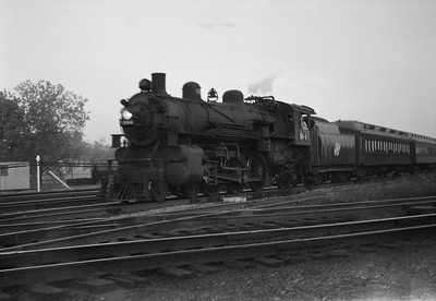 2021.001.NO.03.014--ralph wehlitz 6x9 neg [photographer unknown]--C&NW--steam locomotive 4-6-2 E 584 on commuter passenger train--Mayfair (Chicago) IL--no date