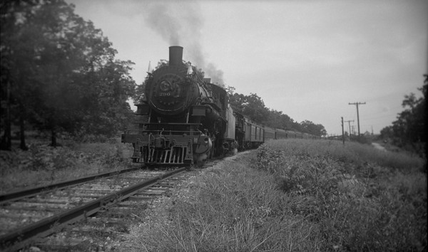 2021.001.NO.03.005--ralph wehlitz 116 neg [photographer unknown]--C&NW--steam locomotive 4-6-0 R-1 290 doublehead on passenger train fantrip--location unknown--no date