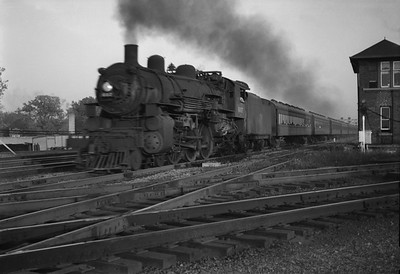 2021.001.NO.03.015--ralph wehlitz 6x9 neg [photographer unknown]--C&NW--steam locomotive 4-6-2 E-S 607 on commuter passenger train--Mayfair (Chicago) IL--no date