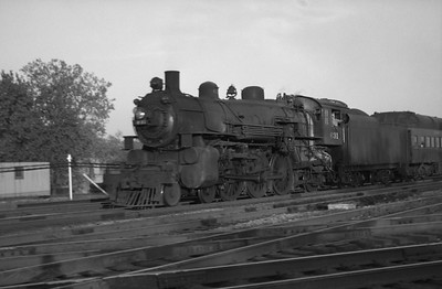 2021.001.NO.03.017--ralph wehlitz 127 neg [photographer unknown]--C&NW--steam locomotive 4-6-2 E-S 631 on commuter passenger train--Mayfair (Chicago) IL--no date