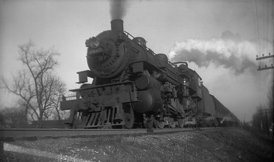 2021.001.NO.03.023--ralph wehlitz 116 neg [photographer unknown]--C&NW--steam locomotive 4-6-2 E-S 1597 on commuter passenger train action--Chicago IL--no date