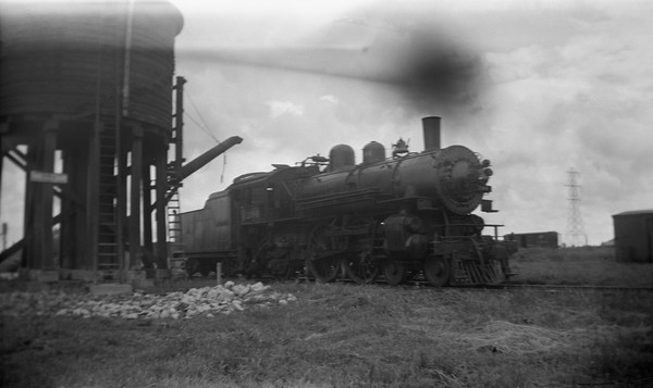 2021.001.NO.03.007--ralph wehlitz 116 neg [photographer unknown]--C&NW--steam locomotive 4-4-2 D 394 at water tank--Janesville WI--no date