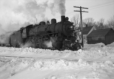 2021.001.NO.03.016--ralph wehlitz 6x9 neg [photographer unknown]--C&NW--steam locomotive 4-6-2 E-S 614 on passenger train--Marshfield WI--no date